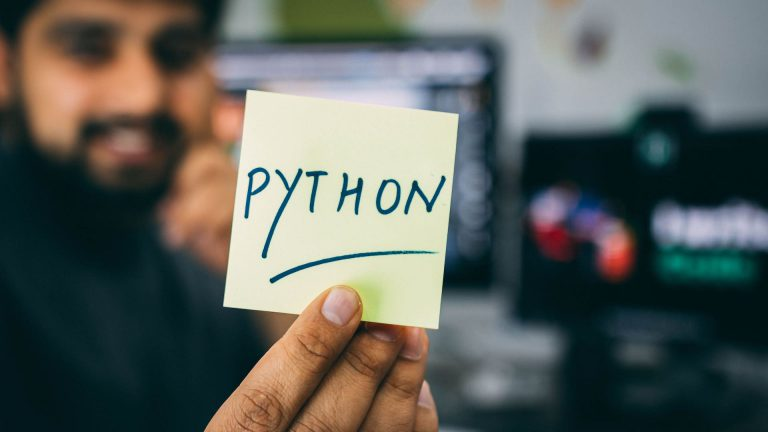person holding note written python